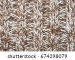 brown knitting fabric texture... | Shutterstock . vector #674298079