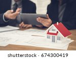 real estate agent with client... | Shutterstock . vector #674300419