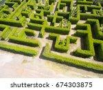 aerial view of green maze garden | Shutterstock . vector #674303875