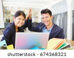 happy asian start up founders...   Shutterstock . vector #674368321