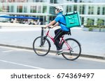 courier on bicycle delivering... | Shutterstock . vector #674369497