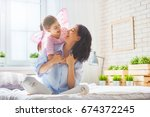 happy loving family. mother and ... | Shutterstock . vector #674372245