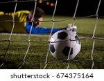 close up of soccer ball in goal ... | Shutterstock . vector #674375164