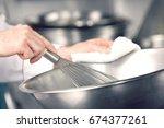 closeup of hands mixing...   Shutterstock . vector #674377261