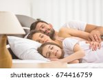 the happy family sleeping on... | Shutterstock . vector #674416759
