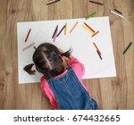 adorable little girl drawing...   Shutterstock . vector #674432665