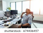 happy entrepreneur at his desk... | Shutterstock . vector #674436457