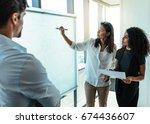 two businesswomen analyzing... | Shutterstock . vector #674436607