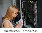 young woman engineer it with a... | Shutterstock . vector #674437651