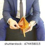empty men's wallet. no money or ... | Shutterstock . vector #674458015