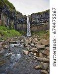 famous icelandic svartifoss... | Shutterstock . vector #674473267