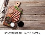 grilled beef steak with spices... | Shutterstock . vector #674476957