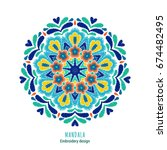embroidered mandala design.... | Shutterstock .eps vector #674482495