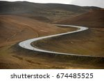 Curved Road Leading Through A...