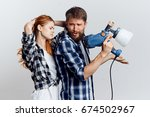 young couple doing repairs  man ... | Shutterstock . vector #674502967