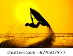 man drive freestyle jet ski at... | Shutterstock . vector #674507977