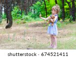 a little girl hugs the teddy... | Shutterstock . vector #674521411
