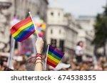 a spectator waves a gay rainbow ... | Shutterstock . vector #674538355