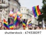 a spectator waves a gay rainbow ... | Shutterstock . vector #674538397