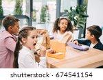 multiethnic group of schoolkids ... | Shutterstock . vector #674541154