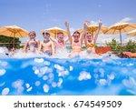 children play fun with splashes ... | Shutterstock . vector #674549509