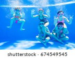little kids swimming  in pool ... | Shutterstock . vector #674549545
