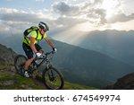sunset mountain bike trip | Shutterstock . vector #674549974