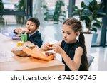 cute little classmates eating...   Shutterstock . vector #674559745