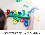little boy playing with figures ... | Shutterstock . vector #674563327