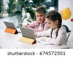 cute caucasian schoolkids using ... | Shutterstock . vector #674572501