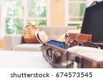 packing a suitcase and backpack ... | Shutterstock . vector #674573545