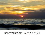 beautiful blazing sunset... | Shutterstock . vector #674577121