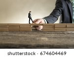 man solving problems by... | Shutterstock . vector #674604469