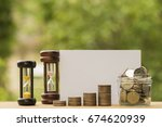 row of coins with hourglass and ... | Shutterstock . vector #674620939