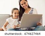 mom teaching daughter working...   Shutterstock . vector #674627464