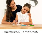 young mother helping her...   Shutterstock . vector #674627485