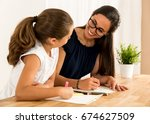 young mother helping her... | Shutterstock . vector #674627509