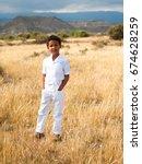 nice cute boy walks in the park | Shutterstock . vector #674628259