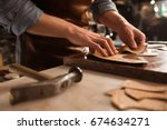 close up of a shoemaker working ... | Shutterstock . vector #674634271