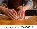 close up of a shoemaker cutting ... | Shutterstock . vector #674634511