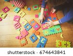 kids playing with puzzle ... | Shutterstock . vector #674643841