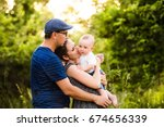 young family with little son in ... | Shutterstock . vector #674656339