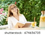 portrait of a laughing woman... | Shutterstock . vector #674656735