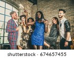 multicultural group of friends... | Shutterstock . vector #674657455
