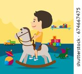 A Boy Is Riding A Toy Horse...