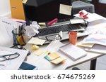 messy and cluttered office desk | Shutterstock . vector #674675269