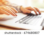 hands with laptop typing | Shutterstock . vector #674680807