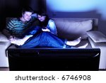 couple on couch watching tv  ...   Shutterstock . vector #6746908