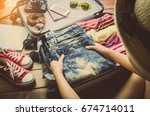 tourists are packing luggage... | Shutterstock . vector #674714011