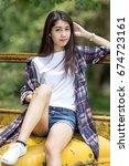 asian girls wear plaid shirts... | Shutterstock . vector #674723161